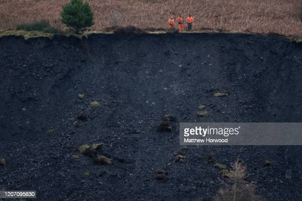 Workers appear to inspect a landslide in the Rhondda valley on February 18 in Tylorstown Wales Inspections of old coal tips on the mountains in the...