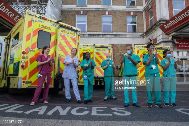 """Workers applaud key workers at Kings College Hospital in South London on May 14, 2020 in London, United Kingdom. Following the success of the """"Clap..."""