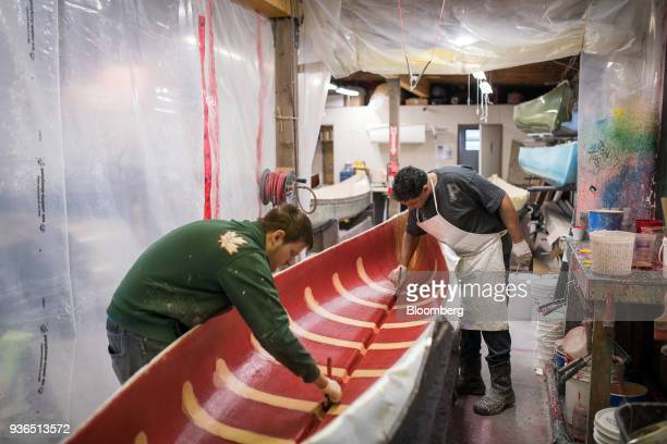 Workers apply fiberclass resin to a canoe at the Holy Cow Canoe Co production facility in Guelph Ontario Canada on Thursday March 1 2018 Statistics...