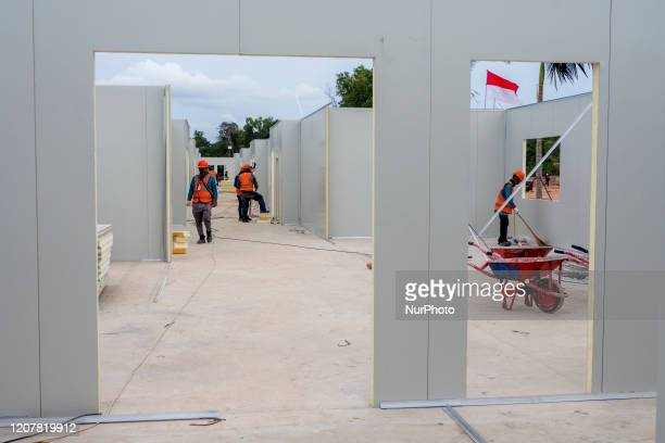 Workers are building a special Corona hospital building in the former Camp Vietnam area on Galang Island Batam Riau Islands on March 20 2020 The...