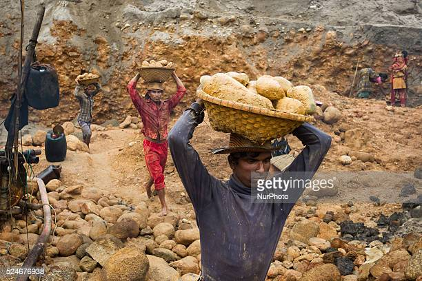Workers are carrying stones outside of the stone extraction site on April 4 2015 in Jaflong Sylhet Bangladesh Stone workers live a miserable life in...