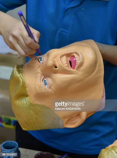 Workers are coloring new elected american president Donald Trump's rubber mask at Ogawa Design Studio in Omiya, Saitama, Novembre 14 Japan. An order...