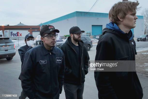 Workers are escorted from the property after a shooting the Henry Pratt Company on February 15 2019 in Aurora Illinois Five people were reported dead...