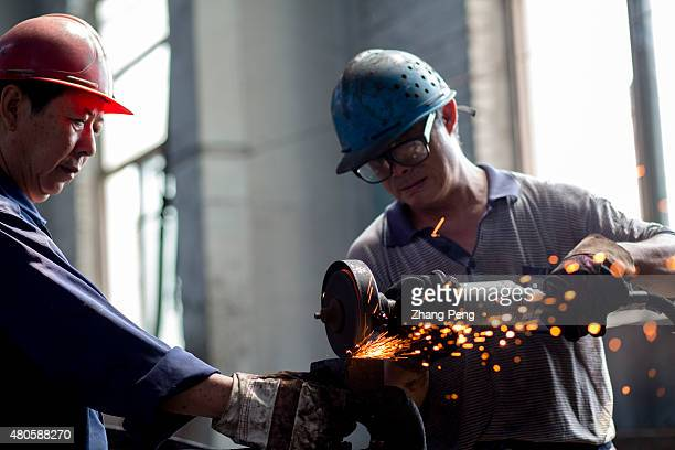 Workers are fixing and replacing the parts of a steam train Fuxin located in China's northeast Liaoning Province which had the biggest open cast mine...