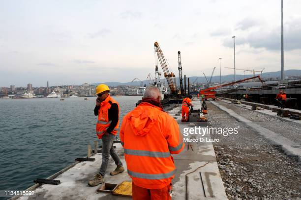 Workers are seen at the construction of the new logistics platform at Trieste's new Port on April 3, 2019 in Trieste, Italy. The 130 million Euro...