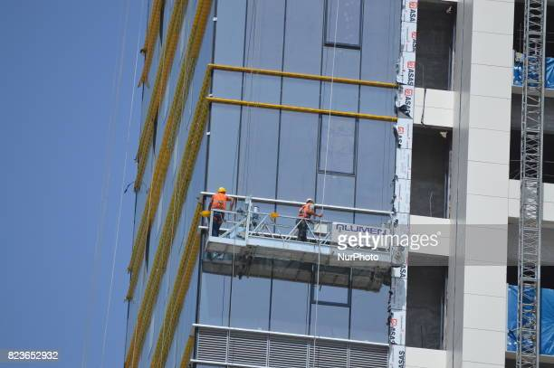 Workers are seen at the construction site of Turkey's biggest retractableroof shopping mall which will be opened in September in Ankara Turkey on...