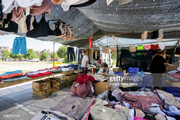 Workers are seen at the recently reopened San Fernando de Henares municipal market with a reduction in the number of stalls on May 29 2020 in San...