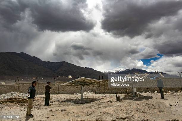 Workers are seen at the site of what will be a solar energy park built by the Ladakh Renewable Energy Development Agency in Leh on June 12 2017 in...