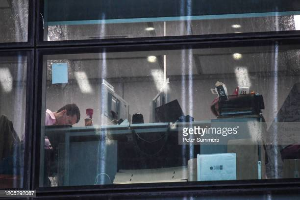 Workers are seen at their desks inside the HSBC tower at Canary Wharf on March 5 2020 in London England HSBC cleared the research department earlier...