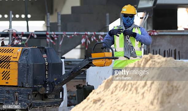 Workers are seen during a tour at the construction site of the Al Bayt Stadium and the workers accommodation on January 9 2017 in Doha Qatar Al Bayt...