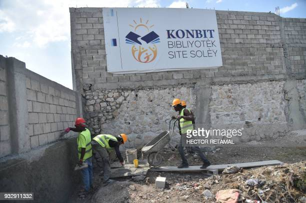 Workers are seen during the construction of the library Konbit bibliotek Site Soley in a neighborhood of the commune of Cite Soleil in the capital of...