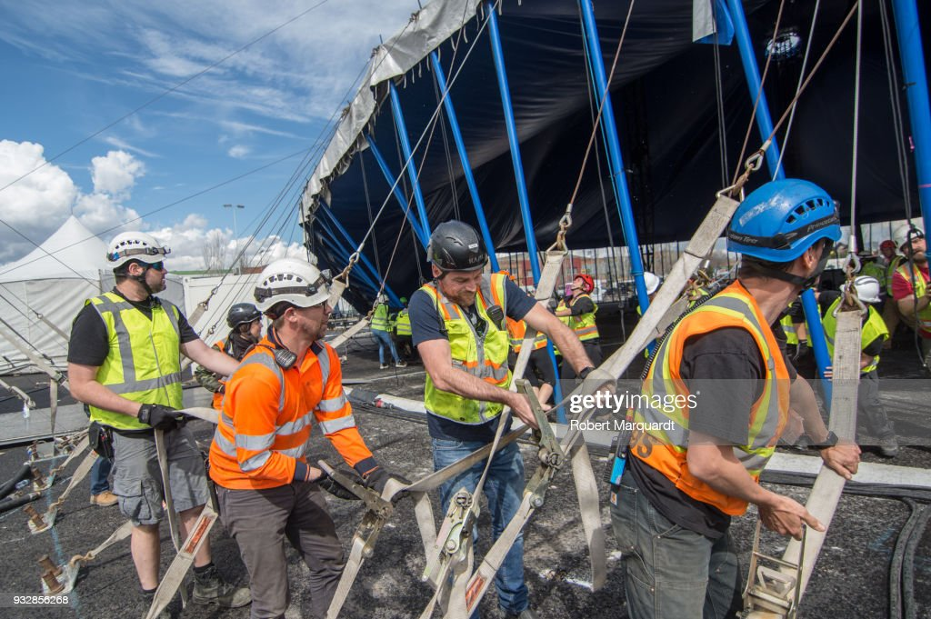 Workers are seen erecting the main Cirque Du Soleil tent for their latest show u0027Totem & Cirque Du Soleil Preparations in Barcelona Photos and Images ...