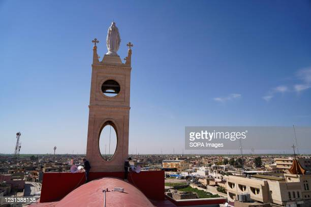 Workers are seen fixing the electricity of the church's dome days before the Pope's historic visit to Iraq. The town of Qaraqosh, 30 kilometres...