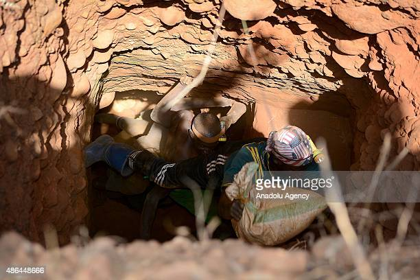 Workers are seen in the channels where they look for gold at a gold mine in the Kirekura region of the Cibitoke Burundi on August 28 2015 People who...