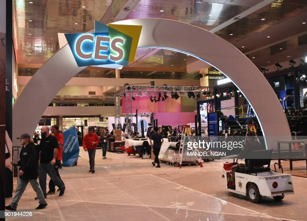 Workers are seen inside of the Las Vegas Convention Center ahead of the opening of the 2018 Consumer Electronics Show in Las Vegas on January 6 2017...