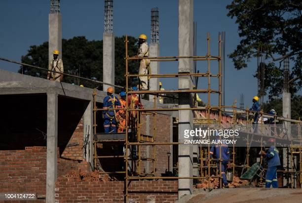 Workers are seen on a construction site of shopping mall on June 29 2018 in the resort town of Victoria Falls After nearly two decades in the...