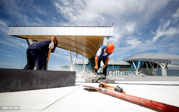 Workers are seen on the construction site of the Platov Airport on August 20 2017 in ERostovonDon Russia