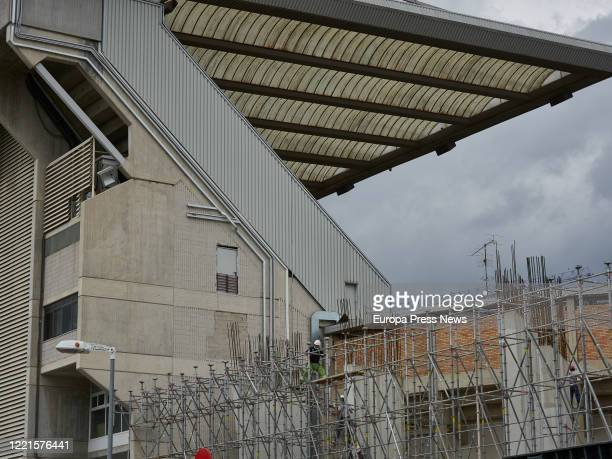 Workers are seen on the reforms of the El Sadar Stadium of Osasuna football club during the state of alarm caused by the Covid19 pandemic on April 27...