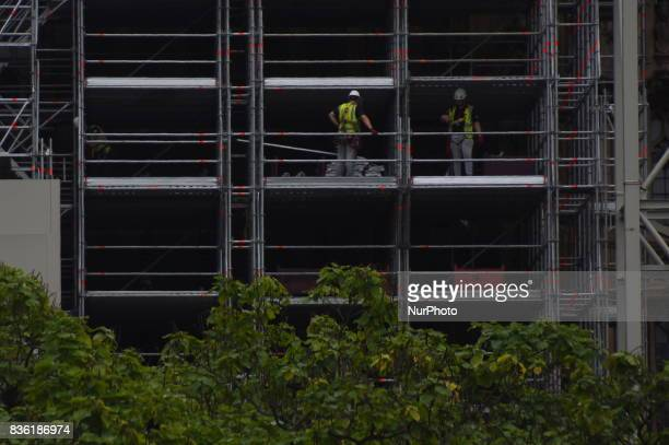 Workers are seen on the scaffoldings while works on the facade of the Elizabeth Tower commonly known as Big Ben London on August 21 2017 Big Ben...