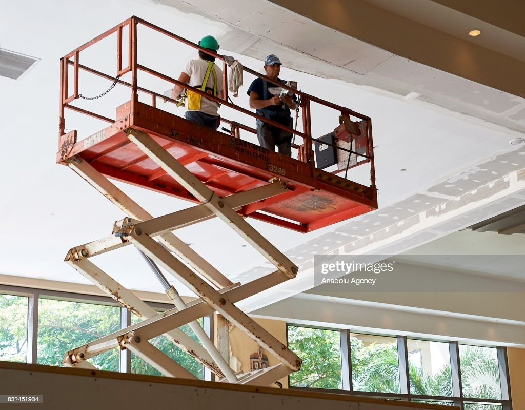 Workers are seen on their duty in Tumon, Guam on August 16, 2017. With the threat of missiles from North Korea the number of tourists have dropped slightly, and while the rest of the world is uneasy, island residents continue on with their daily lives.