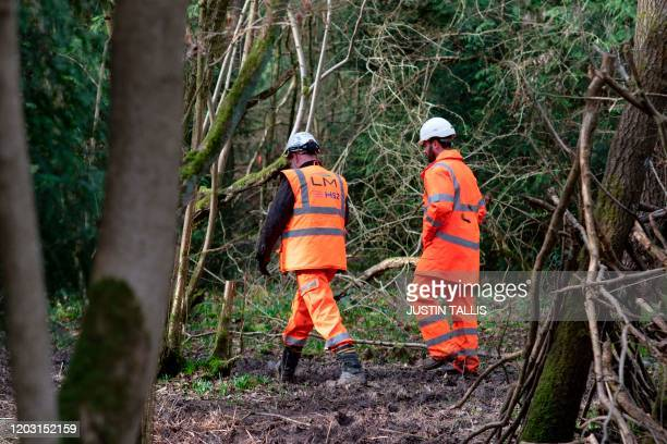 Workers are seen walking through South Cubbington Wood, Leamington Spa, on February 25, 2020 ancient woodland set to be felled to make way for...