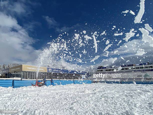Workers are seen working on clearing the venue off snow after heavy snow falls during the night ahead of the opening of the FIS World Ski...