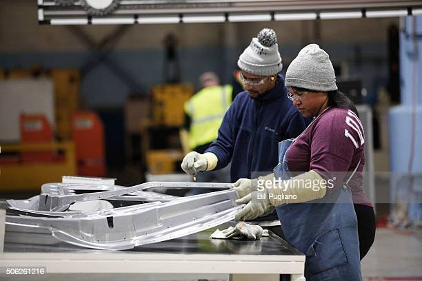Workers are shown at the Fiat Chrysler Automobiles US Warren Stamping Plant January 22 2016 in Warren Michigan FCA US officially dedicated the new...