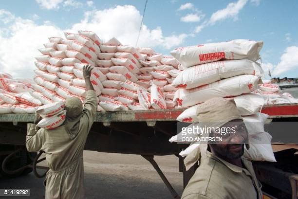 Workers are unloading sacks of maizepowder 10 February wich is the backbone of the diet for most Zimbabweans at a shoppingcomplex in Tafara township...