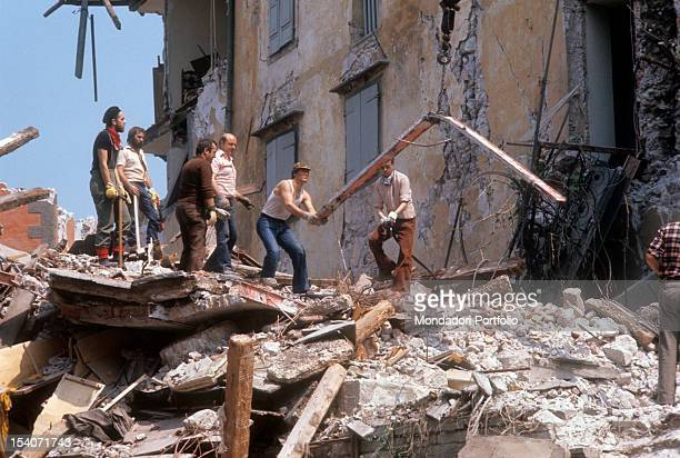 Workers are working to remove the rubble of a house destroyed by the earthquake FriuliVenezia Giulia May 1976