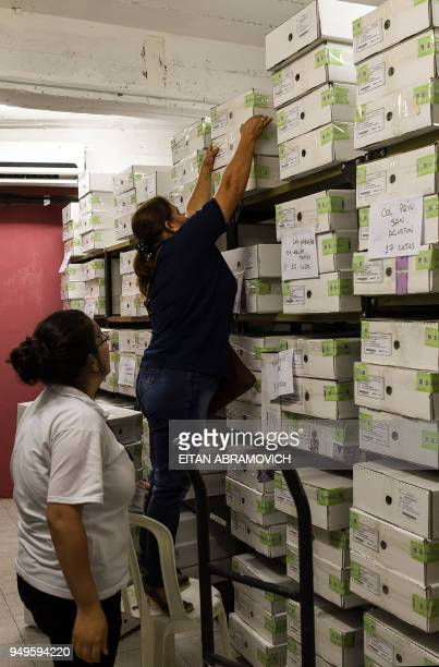 Workers arrange voting material ahead of the upcoming April 22 presidential elections in Asuncion on April 21 2018 Opinion polls give the ruling...