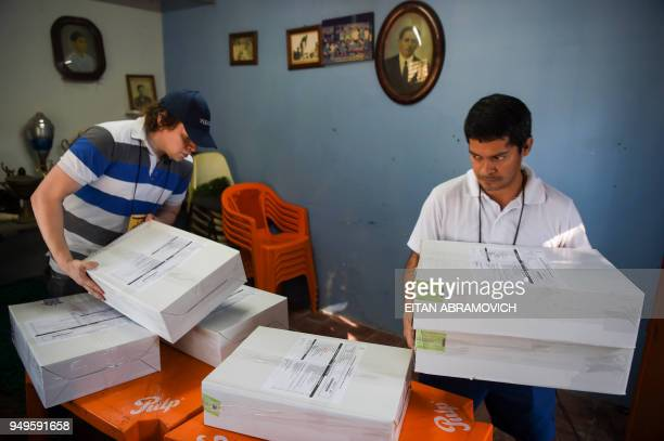 Workers arrange voting material at a polling station ahead of the upcoming April 22 presidential elections in Asuncion on April 21 2018 Opinion polls...