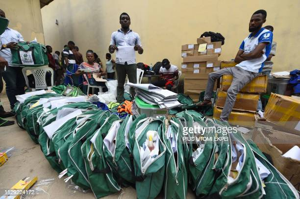 Workers arranges electoral materials before their distribution to wards at the Independent National Electoral Commission central office in Port...