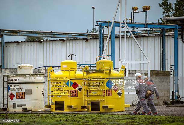 Workers arrive at a Synthexim and Interor chemical plant regulated by the Seveso directive on October 19 near the 'New Jungle' migrants camp in...