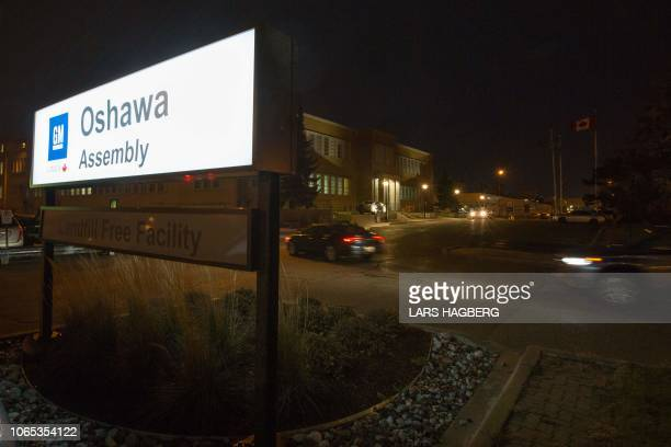 Workers arrive at the General Motors Assembly plant in Oshawa Ontario on November 26 2018 General Motors is to announce on Monday the closure of a...