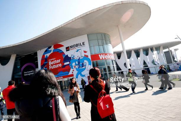 Workers arrive at the main hall of the Mobile World Congress on February 24 2018 ahead of the start of the world's biggest mobile fair held from...