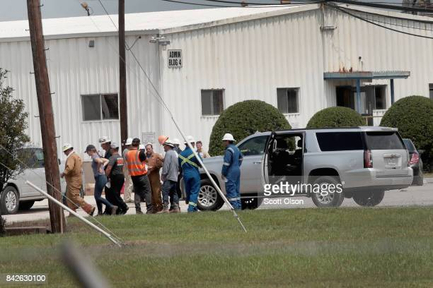 Workers arrive to repair the Arkema plant which received major damage from flooding caused by Hurricane and Tropical Storm Harvey on September 4 2017...