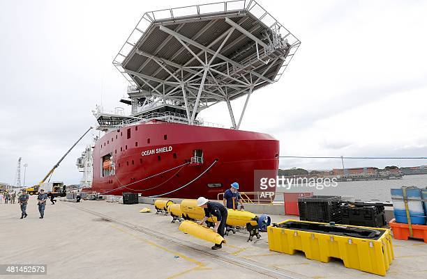 Workers assemble a Blue Fin 21 automatic Underwater Vehicle an autonomous sonar mapping device which will be towed behind the Australian Defence...