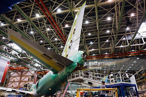 Workers assemble a Boeing Co 747800 Intercontinental Jumbo Jet airplane at the Boeing Everett Factory in Everett Washington US on Wednesday May 29...