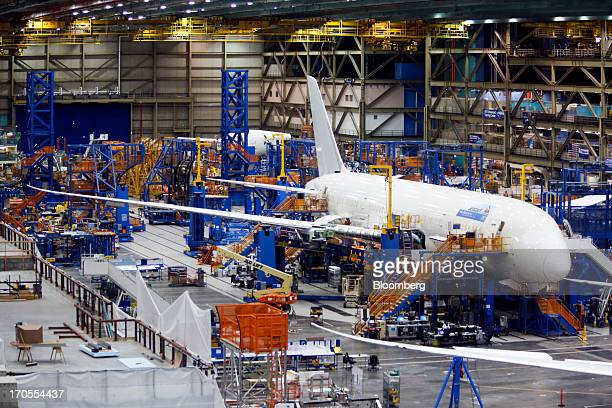 Workers assemble a Boeing Co 787 Dreamliner airplane at the Boeing Everett Factory in Everett Washington US on Wednesday May 29 2013 Boeing Co...