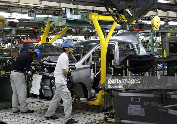 Workers assemble a minicar which will be sold as the Nissan DAYZ by Nissan Motor Co and Mitsubishi eK Wagon by Mitsubishi Motors Corp on the...