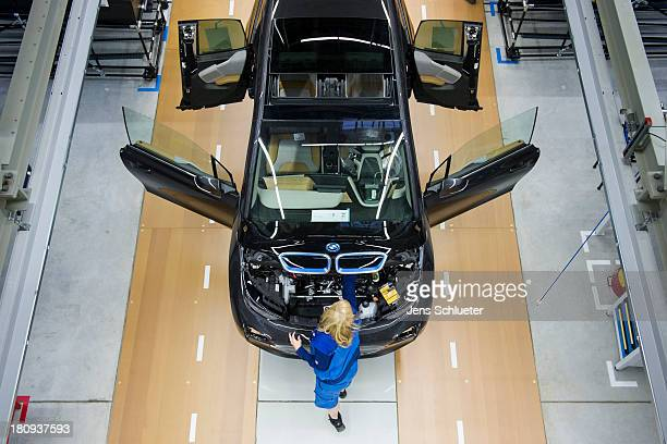 Workers assemble a new BMW i3 electric car on the assembly line at the BMW factory on September 18, 2013 in Leipzig, Germany. The i3 is BMW's first...