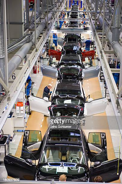 Workers assemble a new BMW i3 electric car on the assembly line at the BMW factory on September 18 2013 in Leipzig Germany The i3 is BMW's first mass...