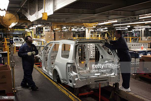 Workers assemble a Taurus X vehicle at the Torrence Avenue Ford Assembly Plant June 22, 2007 in Chicago, Illinois. Ford builds the new Ford Taurus,...