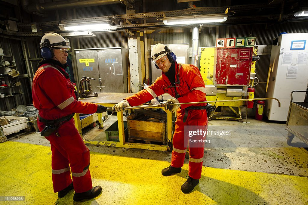 Workers assemble a tool aboard the Oseberg A offshore gas platform operated by Statoil ASA in the North Sea 140kms from Bergen, Norway, on Friday, Jan. 17, 2014. Statoil, Norway's biggest energy company, sees the potential to keep domestic oil and gas output at today's levels until 2025 and possibly beyond even as it tightens spending amid rising costs. Photographer: Kristian Helgesen/Bloomberg via Getty Images