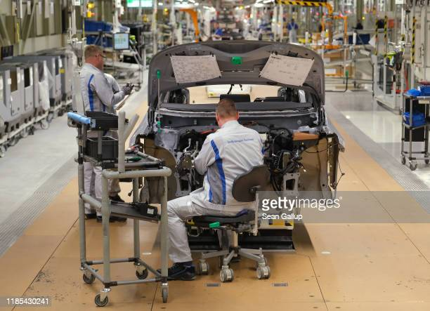 Workers assemble a Volkswagen ID.3 electric car at the Volkswagen factory on November 04, 2019 in Zwickau, Germany. Volkswagen launched assembly of...