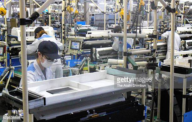 Workers assemble air conditioners at Daikin Industries Ltd Shiga factory on July 3 2015 in Kusatsu Shiga Japan