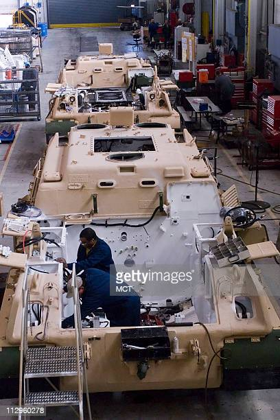 Workers assemble an M88 at the Anniston Army Depot in Anniston Alabama on Tuesday December 5 2006