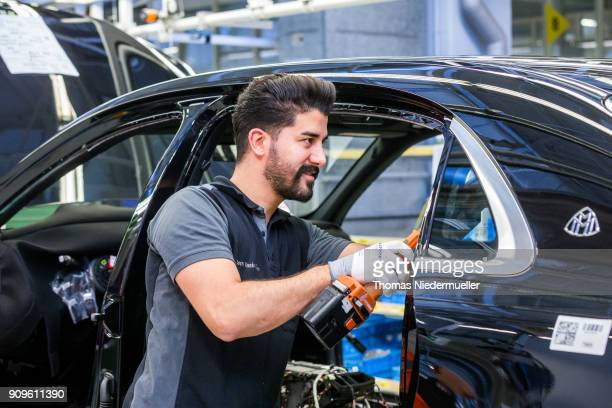 Workers assemble an Maybach sedan at the MercedesBenz plant on January 24 2018 in Sindelfingen Germany Daimler AG which owns the MercedesBenz brand...