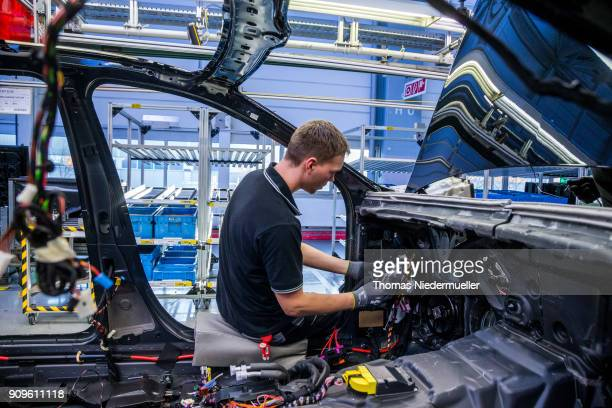 Workers assemble an SClass sedan at the MercedesBenz plant on January 24 2018 in Sindelfingen Germany Daimler AG which owns the MercedesBenz brand...