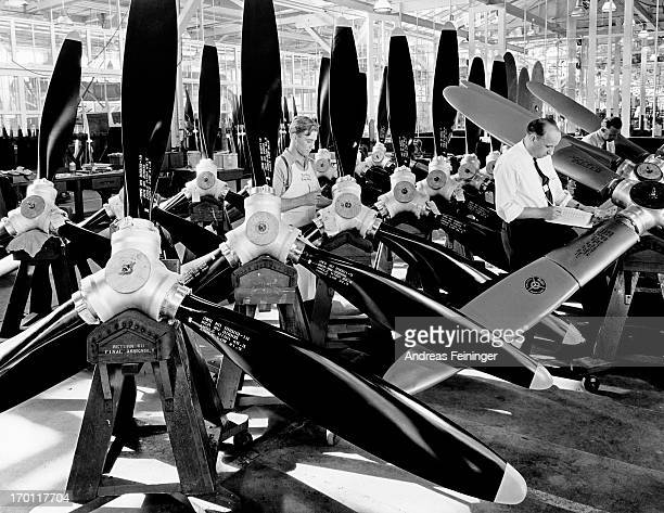 Workers assemble and finish work on propellers at the CurtissWright Corporation factory Clifton New York 1941